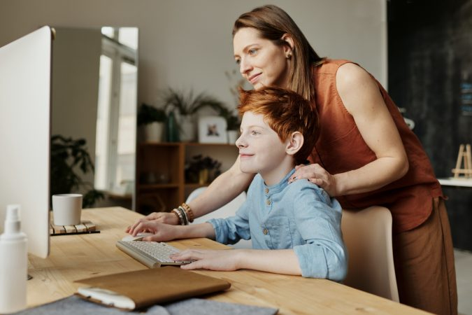 Mother and son looking at computer | Continuity of Learning
