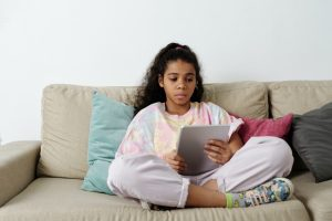 Tween girl reading tablet | Online Resources from Caroline County Public Library